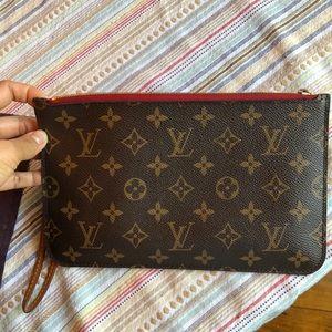 Louis Vuitton wristlet wallet.